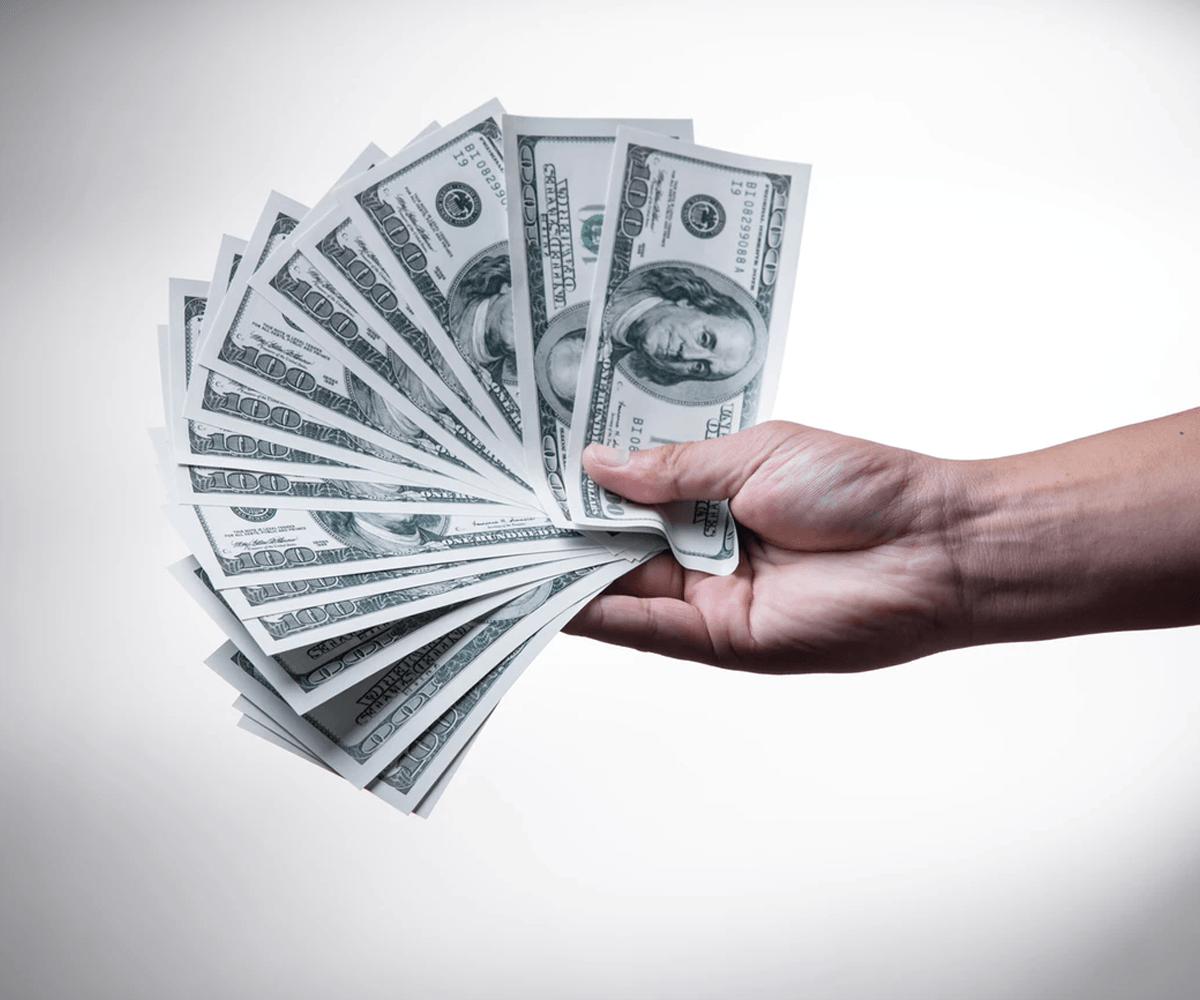 hand with cash Orbit Same Day Richmond Virginia